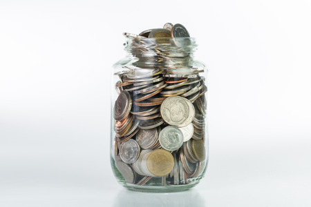 saving: Saving money into bottle for cash in future investment