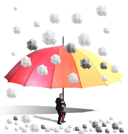 wastrel: Raining Crumpled white A4 paper drop to colorful umbrella holding by businessman for avoid issue and problem from him