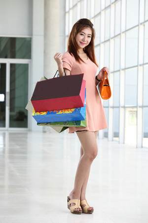 Asian women on holding a lot of shopping bag in Super market photo