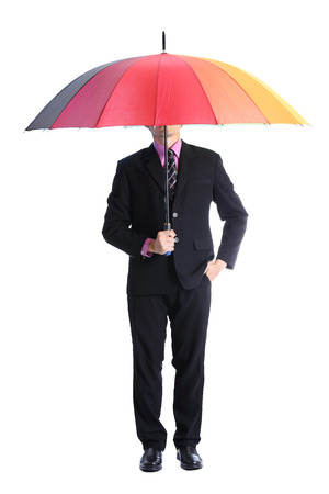Businessman holding rainbow umbrella  with clipping path photo