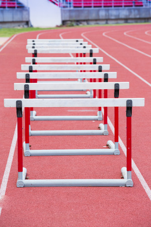 hurdling: hurdles on the red running track prepared for competition Stock Photo