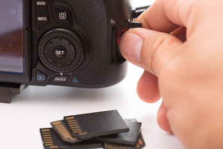 sd: Stack black memory SD card isolated with white background Stock Photo