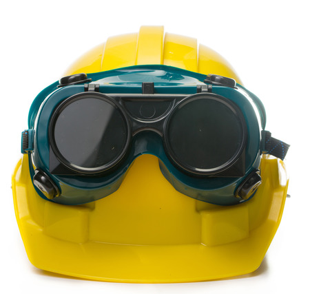Safety hat and goggles glasse isolated with white background photo