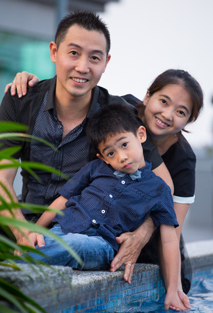 Asian Family portrait in sky garden outside photo