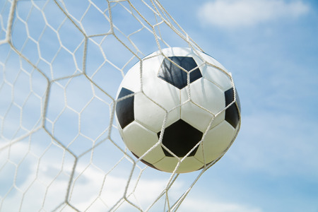Soccer ball in the goal after shooted in the game photo