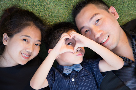 Asian Family portrait in sky garden outside