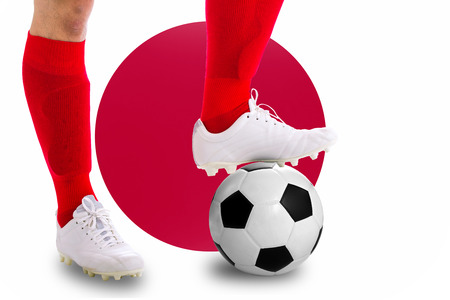 match head: Japan soccer player with football for competition in Match game.