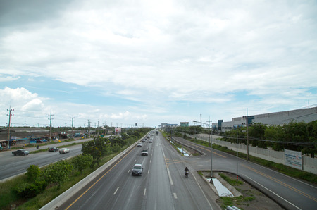 Strom: Traffic in super high way with thunder strom sky Editorial