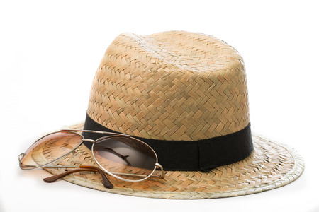 Sunglasses, Hat and Sun block cream with white background photo