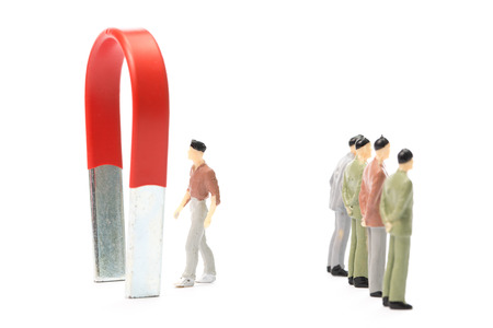 strong magnetic field: Businessman used large magnet for attracts benefit income with their marketing Stock Photo