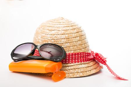 Sunglasses, Hat and Sun block cream on white background photo