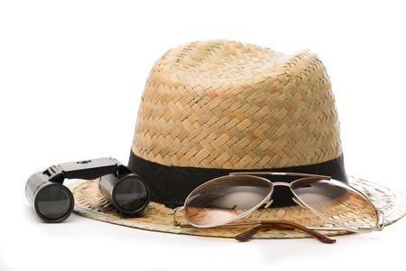 Sunglasses, Hat and Binoculars with white background photo