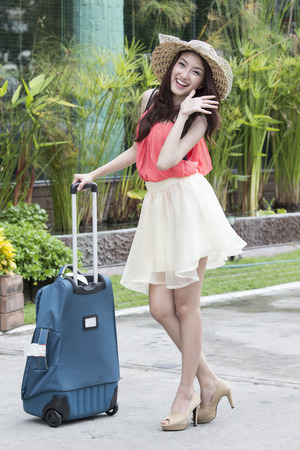 Lovely travel girl prepare to go the airport in hotel photo