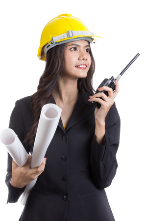 Asian Enigeer hold radio FM for call and work with team with white background photo