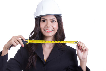 Asian Engineer women hold measure tape with white background photo