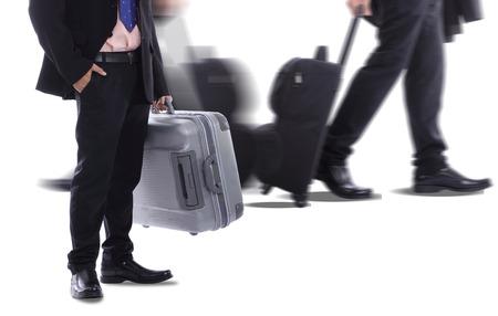 Travel businessman holding luggage for go around the world photo