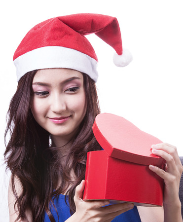 chirstmas: Lovely Asian girl hold gift on chirstmas day Stock Photo