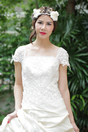 Wonderful Bride with wedding suit in the garden. photo