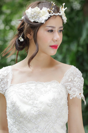 Wonderful Bride with wedding suit in the garden. photo