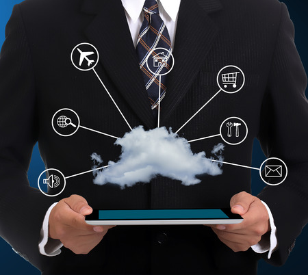 Businessman holding tablet for cloud system networking  photo