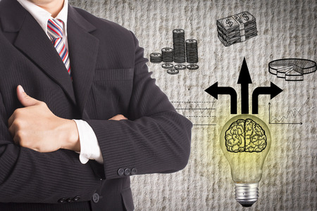 Businessman stand with idea lamp concept for alternative choice  photo