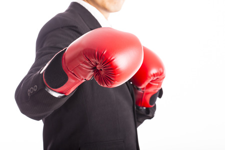 Businessman wear red boxing gloves with white background photo