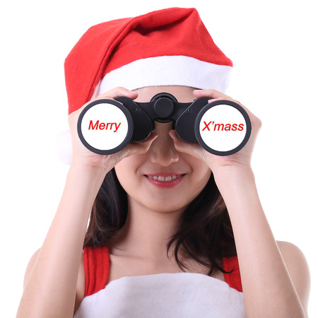Christmas santa girl use binoculars for look and watch with white background photo