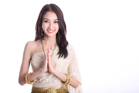 greet: Thai women welcome with traditional Thai suit in Studio Stock Photo
