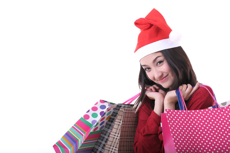 Christmas woman holding shopping bag with white background photo