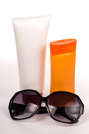 Sunglass ,Hat and Sun block cream with white background photo