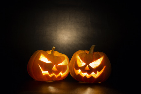 Halloween pumpkins smile and scrary eyes for party night photo
