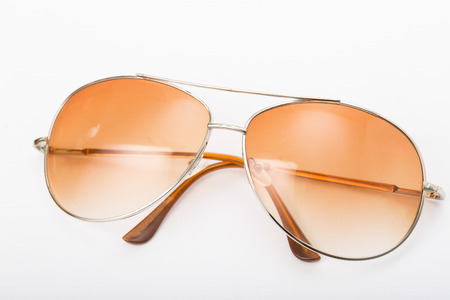 sunglasses reflection: Close up Sun glasses on the table with white background