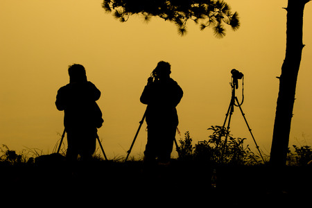 Silhouette photographers take camera landscape in Phukaduang Nationala park Thailand photo
