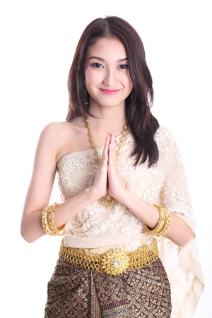 Thai women welcome with traditional Thai suit in Studio 写真素材
