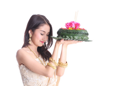 Asian women holding Khratong for wish and respect god of river on Roikhratong Day with white background photo