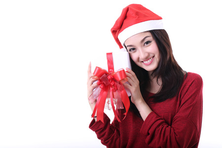 Christmas Asian Santa girl hold gift and smile with white background photo