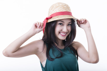 Yong girl hold fashion hat with white background photo