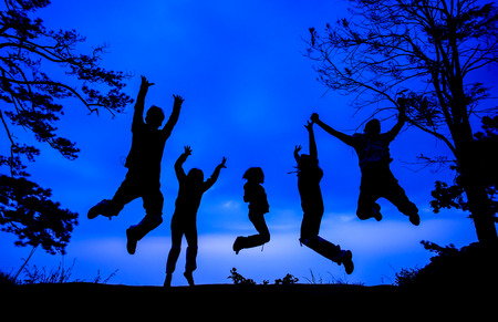Grouping people jumping with silhouette in twilight time photo