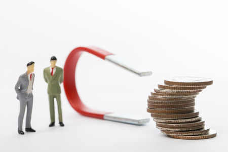 Businessman used large magnet for attracts benefit income with their marketing Stock Photo