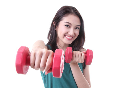 Young Asian women trainning muscular of hand with red dumbbells ,1kg photo