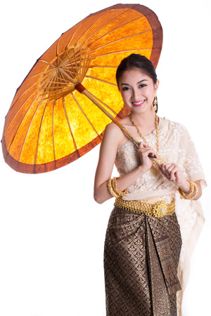 traditional culture: Asian women holding paper umbrella and smile with Traditional Thai suit Stock Photo