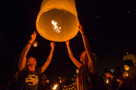 CHIANGMAI,THAILAND-OCTOBER 25:Lanna Kathina ceremony . European people released Lantern floating which made of paper for paying homage to the loard Buddha on OCT. 25,2014 in Chiang Mai, Thailand.