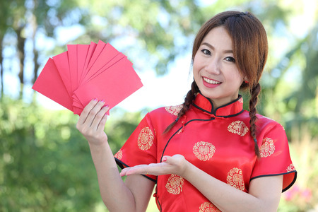 fortunate: Chinese girl  hold red envelope in new year