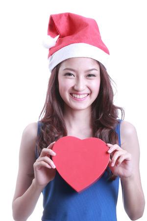 chirstmas: Lovely Asian santa girl hold gift on chirstmas day Stock Photo