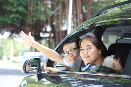 latin mother: Travel Asian Family preparing with her son in the car Stock Photo