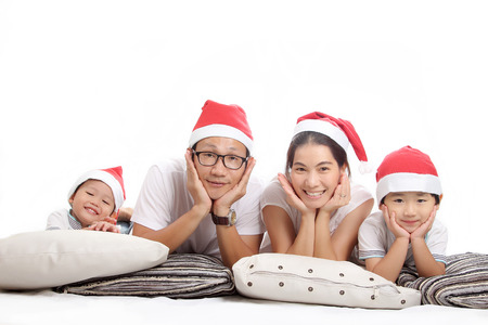 Family christmas with Santa caps on December 25th. photo