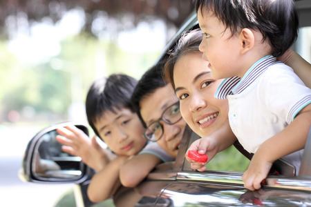 transportation travel: Travel Asian Family preparing with her son in the car Stock Photo