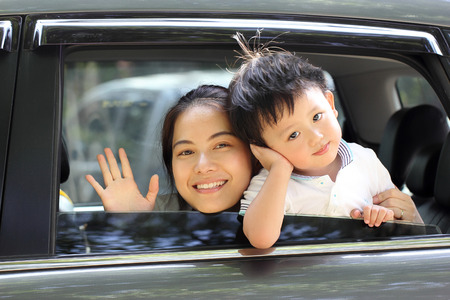 Travel Asian Family preparing with her son in the car Stockfoto