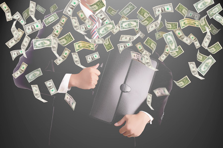 Businessman catching money for investment photo