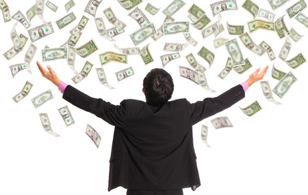 Businessman catching money with open arm photo